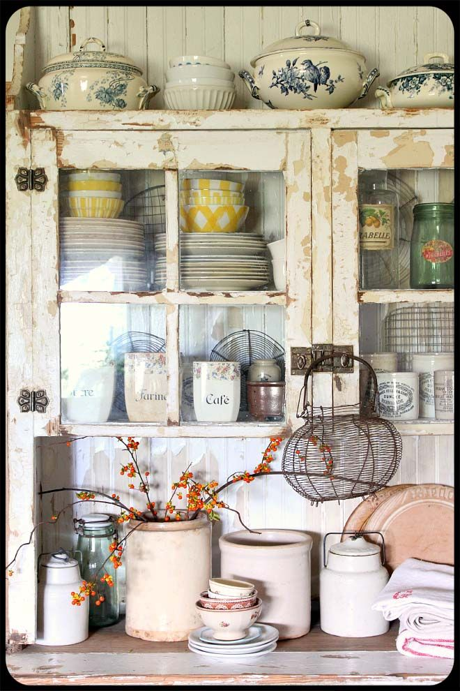 The Old Painted Cottage    The old shelves and old plates/mix of colors. Very cottage styled look!