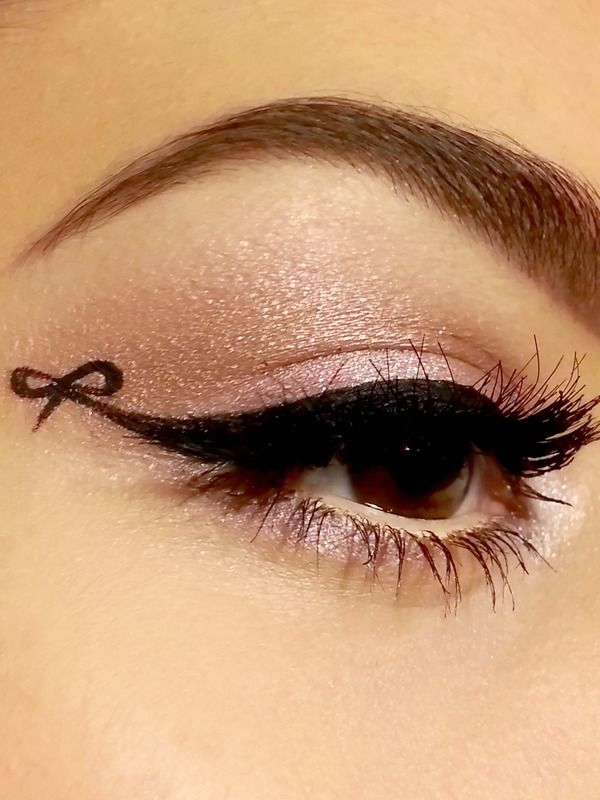 So outrageous,  but I'm loving it!! Winged eyeliner with a bow. :: Dare to be bold:: Bow Liquid Eyeliner:: Bold Retro makeup with a twist!