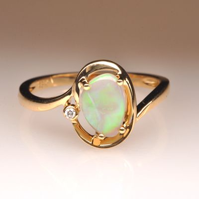 Natural Solid Light Opal 18k Gold Ring. This opal is no exception. It has wonderful colours and excellent Brilliance.
