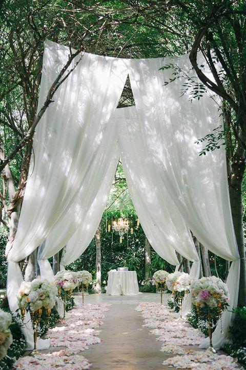Here's how you can do draping at an outdoor wedding ~ http://www.weddingchicks.com/2016/02/26/a-stunning-gold-and-pink-garden-wedding/