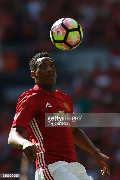 Manchester United's French striker Anthony Martial eyes the ball during the FA Community Shield football match between Manchester United and...