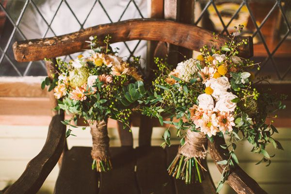 pretty, natural greens tied with an earthy wrap on a wood chair