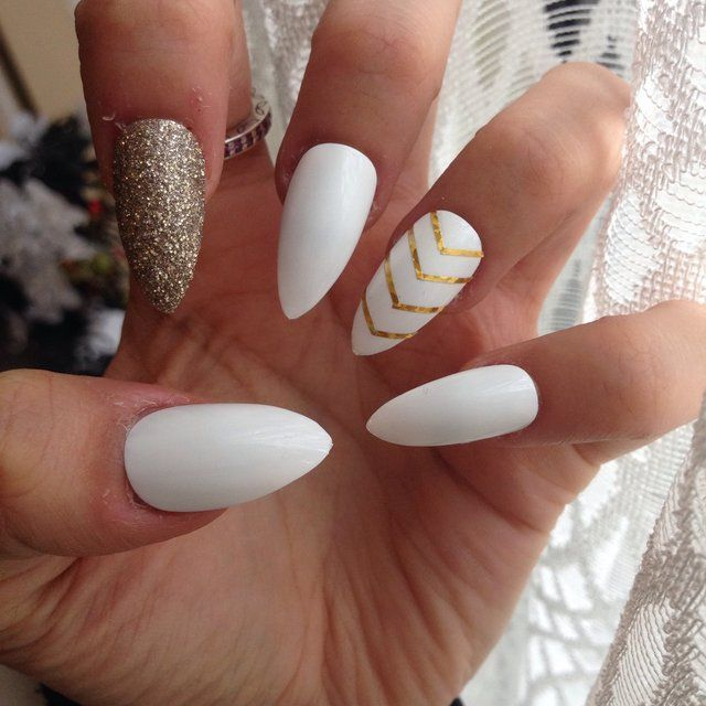 awesome Gorgeous White stiletto nails with gold feature nails for the lovely @francescab...