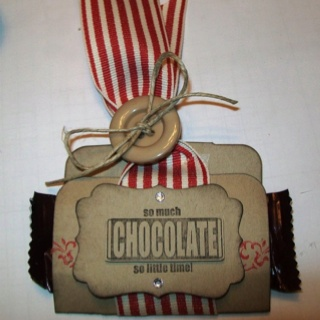 Holiday treat made with Stampin Up stampset, punches, button, and ribbon.