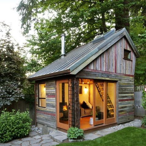 Backyard Room ... the structure has a footprint of just 11 x 14 ... extra living space to entertain, catch up on work, or just relax by the wood-burning stove .. made with reclaimed vintage wood. WOW!!!! What an amazing craft space this would make - I love it! I will have one of these in my future house.