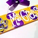 4x12 LSU Tigers Teacher Name Sign. Hand Painted Purple and Gold Wood Sign with LSU Tiger Eye Fleur de Lis for Teachers. $28.00, via Etsy.