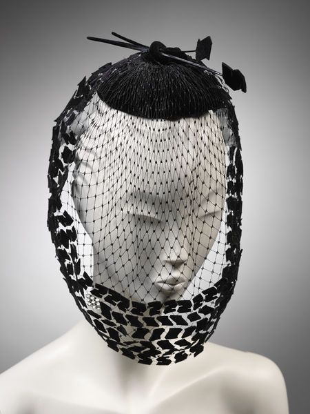 Graham Smith. 1984.This hat was designed by the milliner Graham Smith for the 1985 Pirelli calendar and features the famous tyre tread pattern of the Pirelli P6 tyre. The calendar was introduced by the Pirelli tyre company in 1964 as a trade publication featuring women in glamour photographs and it quickly became a cult item.