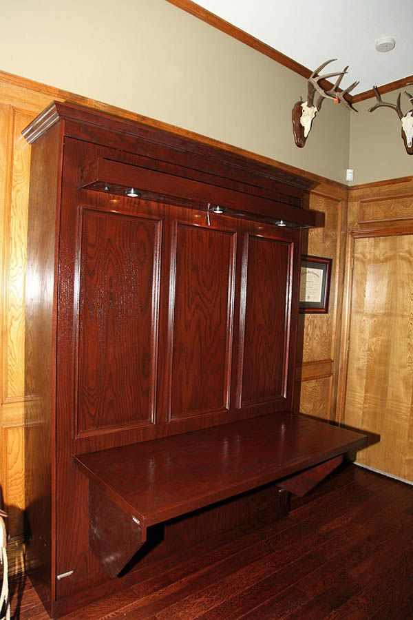 Use all the space in your room. We built a desk into this rustic murphy bed.