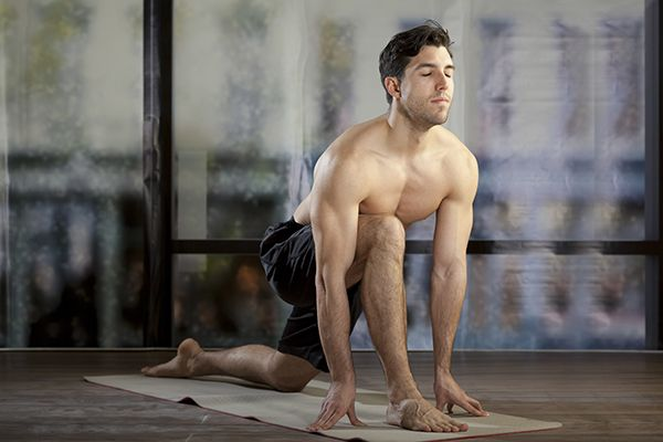 """Most men see yoga as """"glorified stretching"""" with no strength or cardio involved. They are hesitant to walk into a yoga room because they either feel they won't benefit from it, or they don't really understand what yoga is all about. Yet yoga is very much"""