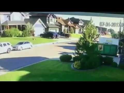 Douche bag trying to steal a truck, gets chased away by neighbor with go...