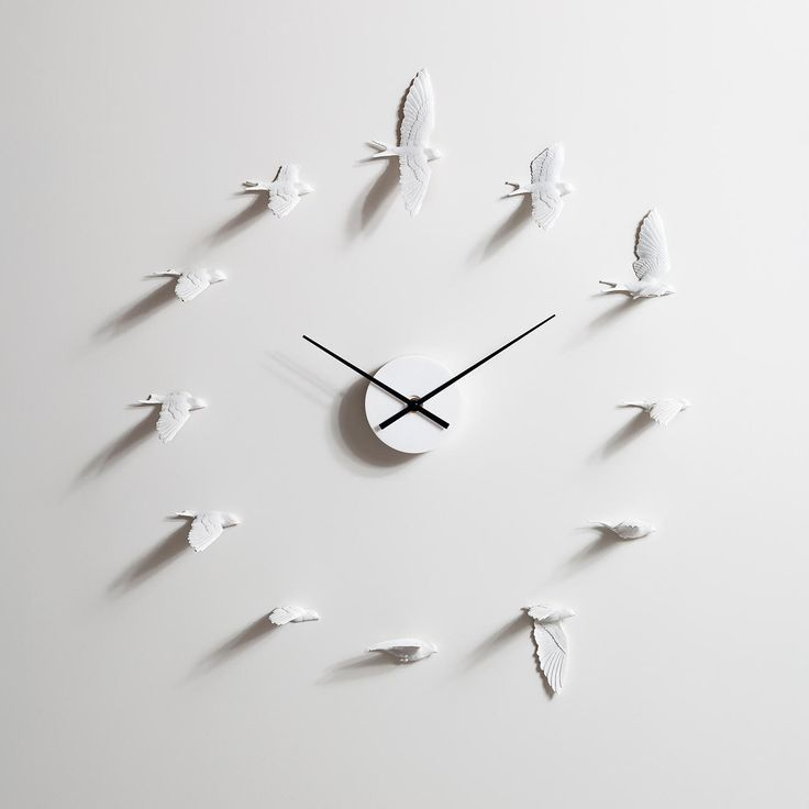 Swallow Clock - Enchanting swallows tell the time. In Asian culture these birds symbolise happiness and success.