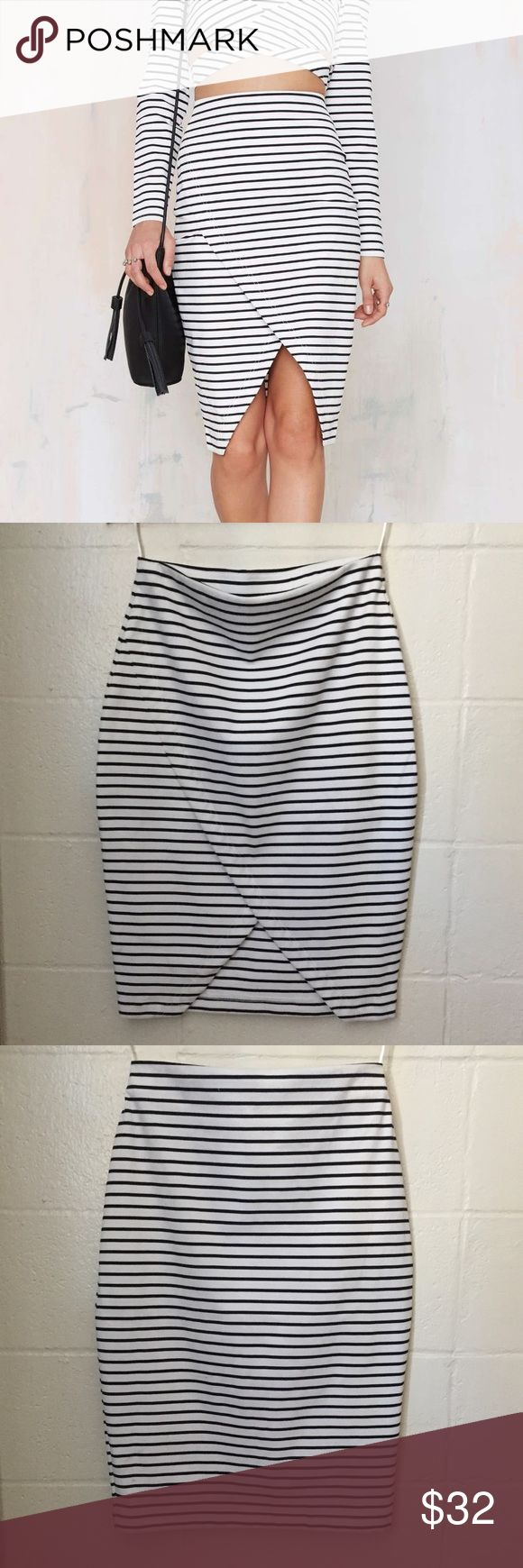 "The Fifth by Nasty Gal striped wrap pencil skirt Asymmetrical, striped, Roadhouse pencil skirt in black and white. Cute for casual events like girls night out! Add some black strappy heels and a black clutch or crossbody.   ✨REASONABLE offers accepted✨  MEASUREMENTS ARE APPROXIMATE Length (waist to longest length of skirt)- 26.5"" Waist: 29-30"" Hips: 39-40"" Nasty Gal Skirts Pencil"