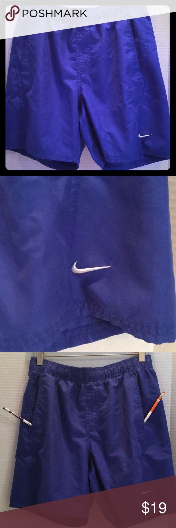 "NIKE Swim Shorts Workout Mesh Lining Royal Blue M Elastic waistband, mesh lined, 2 Pockets NIKE workout swim shorts, interior mesh pocket, Nike laces inside to adjust waist..... Medium...30"" around waist unstretched....11 1/2"" RISE....17 1/8"" waistband to edge of short. EUC [ A-8]✌️💠✌️💠✌️💠 Nike Shorts"