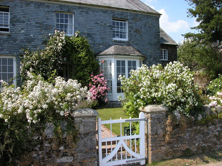 This lovely slate-hung Georgian farmhouse with sash windows sits in the centre of Treworgey Farm and has lovely views down the valley to the river below. http://www.cornishdreamcottages.co.uk/cottage/treworgey-farmhouse
