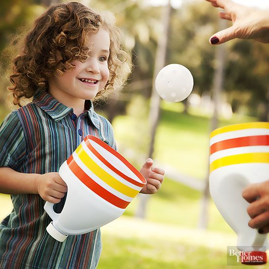 Don't throw away those empty bleach bottles -- transform them into an outdoor catching game! 1. Cut the end off a cleaned bleach bottle and remove the label. 2. Wrap the bottle with colorful tape, and you're ready to play catch!