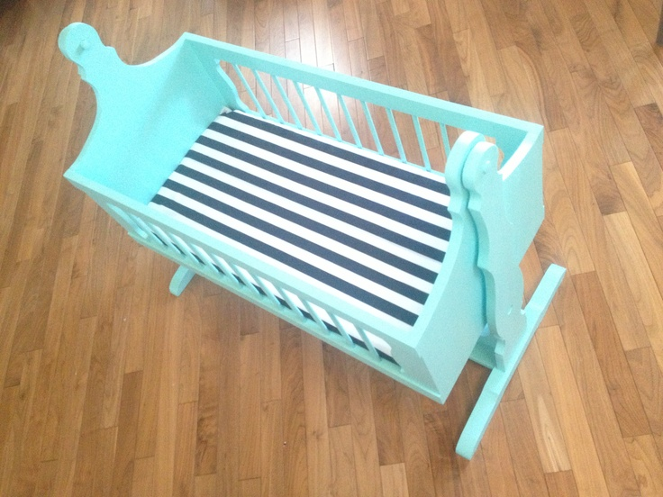 Aqua wooden cradle.