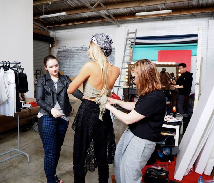 A behind the scenes photo of our advanced students styling an editorial photo shoot.