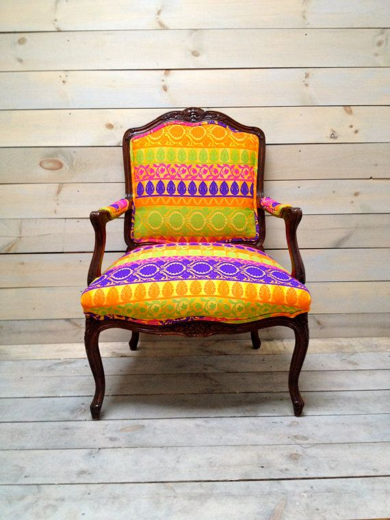 LOVE THIS! French Provencal Armchair Upholstered in Bright Silk by chezboheme on etsy. Sturdy broad-bottomed French chairs groomed and dressed up for the PARTY!! in a pure silk jacquard with tangy, gravity-defying colors.     Thick silk threads of purple, lime, magenta and tangerine are woven in patterned bands across a golden yellow background in classy juxtaposition to their own decadent hues. Double piping on the bias in the same fabric provides balance, if not restraint.