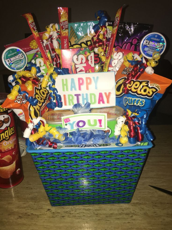 Birthday gift for him! I used decorative tape for the basket. Snacks, basket, bbq skewers, packaging tape, foam blocks, and Hawaiian leis (to cover the foam blocks). got all this at the dollar store!