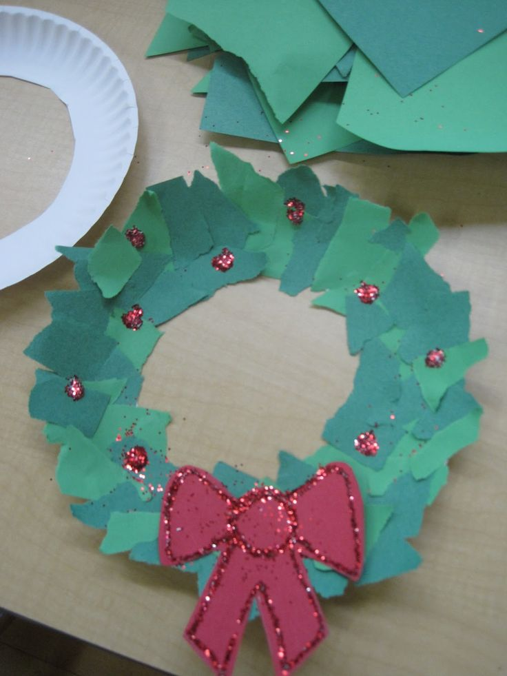 Mrs. Jones's Kindergarten: ripped paper wreaths. Doesn't everything look better with glitter?  Super easy to make! Just cut the center out of a paper plate, grab some different shades of green construction paper, some glue, and some glitter. Kids rip paper by hand and glue to cover the plate. Add some dabs of glue and glitter for holly berries, and a bow if you'd like.
