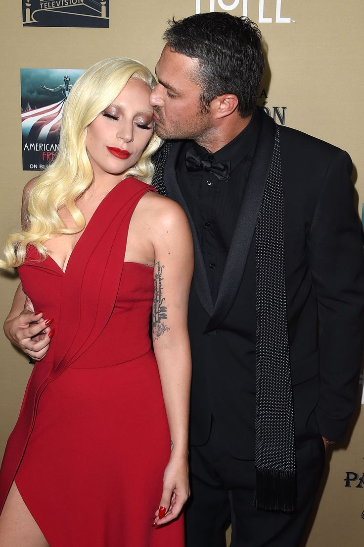 Lady Gaga and fiancé Taylor Kinney celebrate the premiere of American Horror Story: Hotel.   - HarpersBAZAAR.com