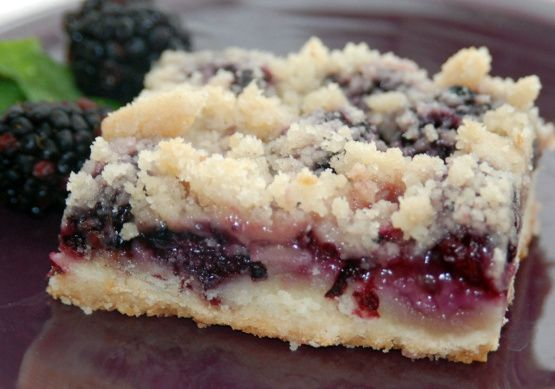 Sweet, sugary, buttery goodness in a pan.  This recipe is from Marsee Baking Company in Portland, Oregon.  When we lived in that area, we used to pick wild blackberries and I could make this delicious dessert at a very low cost.  It was heaven.  The original recipe called for marionberries, but they are interchangeable in this recipe.  I have never tried using frozen berries for this, so I recommend fresh.