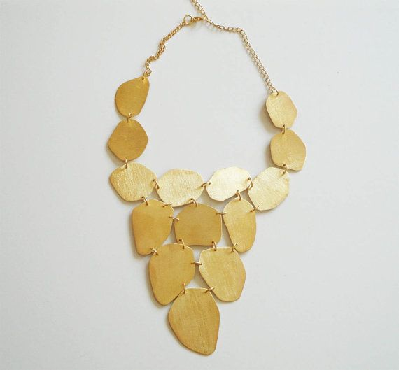 We love this bold necklace that will add a statement to any outfit. It is perfect to dress up a simple white or black T-shirt with jeans. We were sad to find this shop owner is in Greece, or we would be pouncing all over this to get on #sneakpeeq. Until we go global! Found on Etsy by KatiaV.