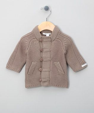 Beige Button Up Cardigan - Infant & Toddlers & Kids from Little Linens This London-based brand has been charming grannies for over 25 years, with vintage-inspired childrenswear that really stands the test of time. Exclusively using fine linens, they ensure unparalleled quality, environmentally-friendly design and complete comfort. With each garment displaying beautiful hand detailing, Little Linen's collection celebrates the craft of needlework.