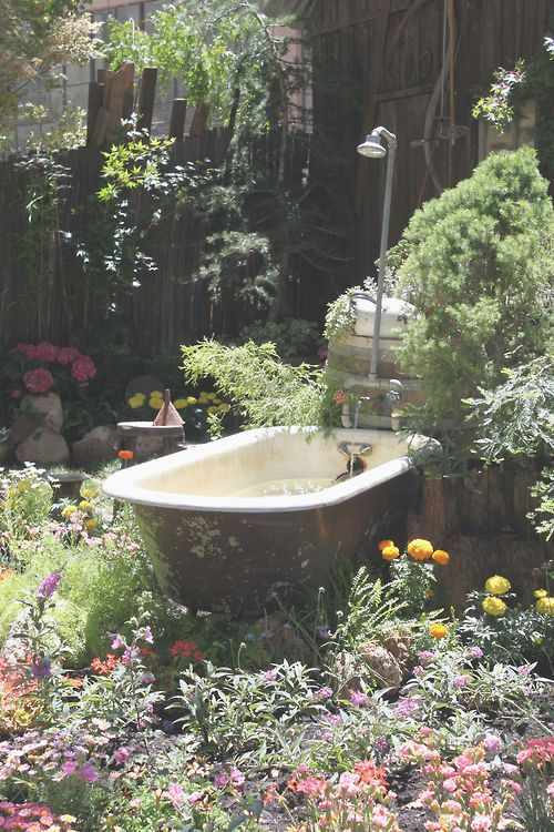 """Why not do the Cealis thing and make an outdoor """"lounging pool"""" from an old tub? Wonderfully quirky"""