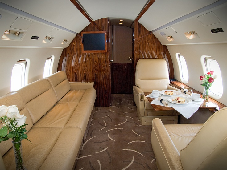 10 passenger seating, gallery, entertainment center, monitors, flight phone, enclosed lavatory, configurable to sleep four