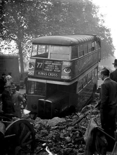 25th, October, 1940, A Bus which fell into a bomb crater in a London street, the front wheels became locked in the hole and the vehicle had to be hauled out (Photo by Popperfoto/Getty Images)