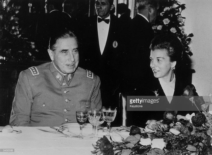 1975: General Augusto Pinochet, the President of Chile, with the Argentinian President, Maria Estela Martinez De Peron, at a dinner given in his honour in Buenos Aires.