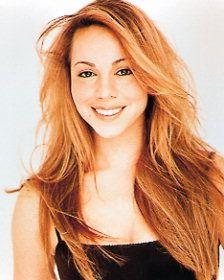 A younger Mariah Carey, looks kind of like Shakira.