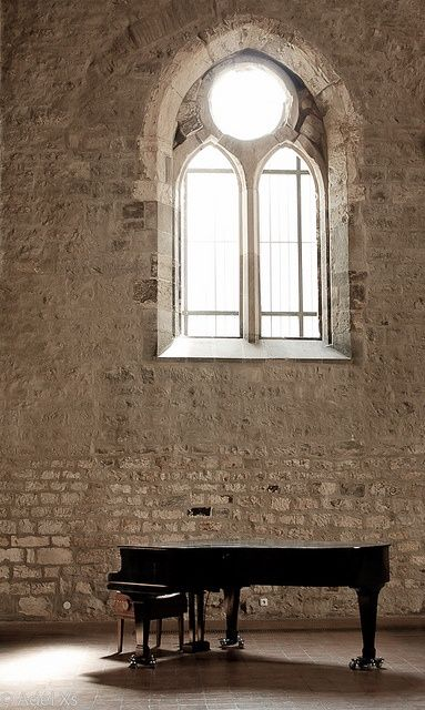 grand piano. stone walls, Gothic window