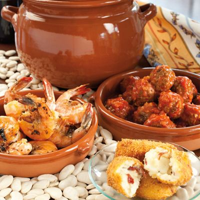 Guests will love these Spanish tapas! Garlic prawns, Spanish meatballs and croquetas.