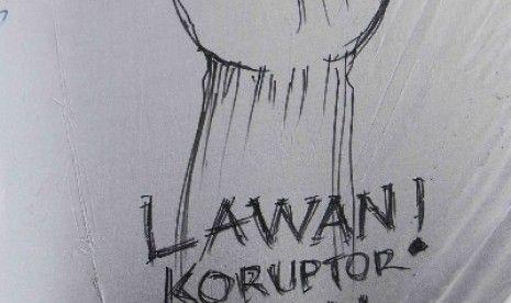Pegawai Komisi Pemberantasan Korupsi (KPK) menandatangani dukungan ketika aksi damai di halaman gedung KPK, Jakarta, Selasa (3/3). Aksi yang diikuti seluruh pegawai KPK tersebut menolak putusan pimpinan KPK yang melimpahkan kasus Komisaris Jenderal Budi Gu