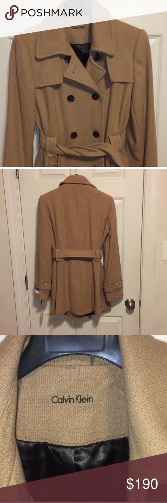 Calvin Klein Pea Coat Camel colored pea coat with waist tie. Tortoise colored buttons. Black lining with red stitching. Label is a Large but fits like a size 8. Calvin Klein Jackets & Coats Pea Coats