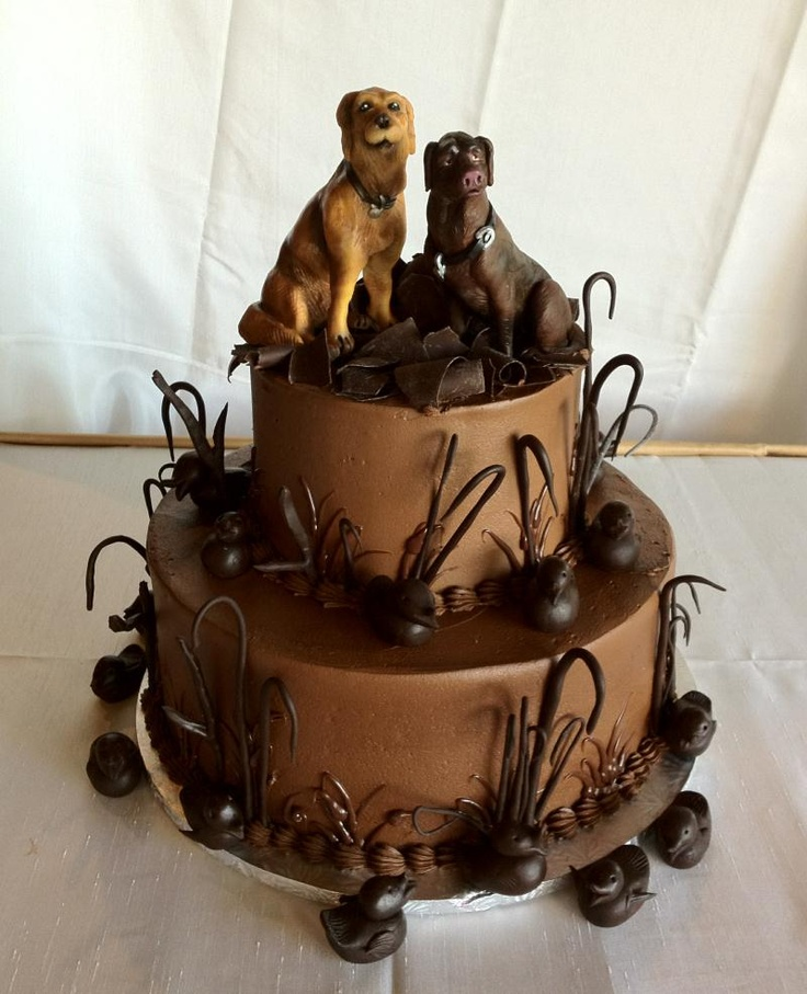 The Cake Guys. love this cake with the dogs on top and the chocolate art.