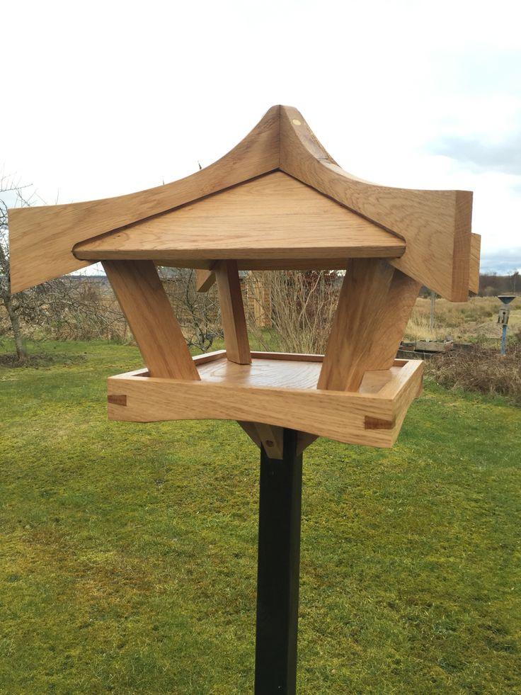 Solid oak pagoda bird table.