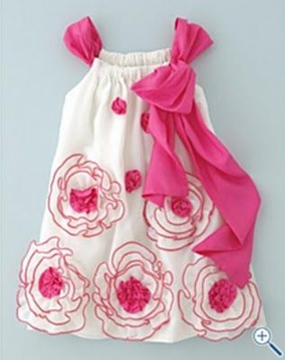 Pillowcase dress with thick straps hat loop front and back and tie on the side in the front. Flowers just look like white fabric with a pink surged edge ...