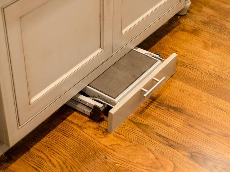 Hidden step stool to access higher cabinets.   Kitchen Layout Design Ideas | DIY Kitchen Design Ideas - Kitchen Cabinets, Islands, Backsplashes | DIY