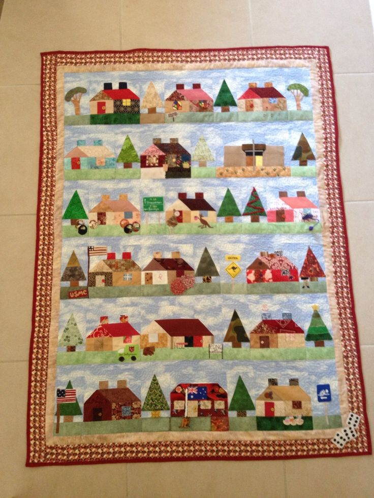 The Wendy quilt made by the Pucka Piecemakers as a farewell gift. Each person made and embellished a block. I added the neighbourhood Centre and the chapel as the venues for her classes. She loved it!