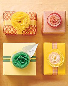 Baking liners make sweet gift toppers for Mother's Day, or anytime.  Nesting pastel papers in different sizes -- petit four, mini muffin, and  cupcake -- creates fluffy blooms that will add a flourish to beribboned  presents.
