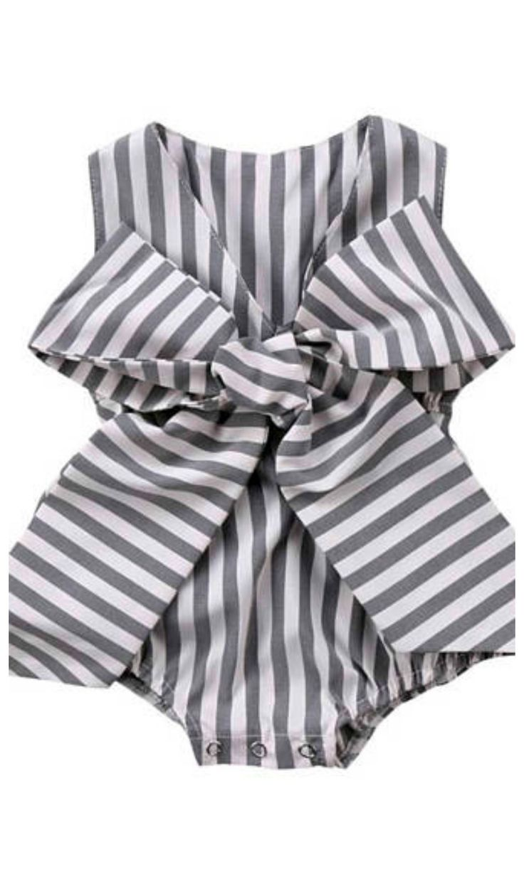 This charcoal grey and white romper is adorable! This romper features large bow on front, 3 snaps on bottom for quick diaper change, and we have added an elastic waistband for comfort. #toddler #affiliate