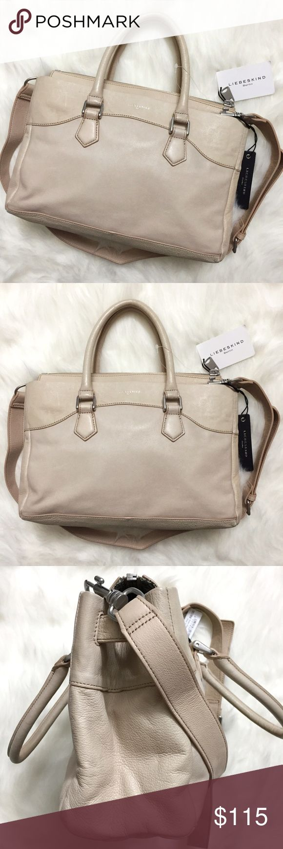 Liebeskind Berlin Georgia Vintage Leather Satchel Brand new with tags & dustbag. Retails for $298! This Liebeskind Berlin Georgia Vintage Leather Satchel Bag is made of the softest, buttery leather! Love that the silver hardware adds just the right amount of toughness! Color is called Powder Rose and looks like a neutral beige color with a tiny hint of powder pink. The color matches with so many outfits! Adjustable strap. Love the light and dark grey interior lining! Top zipper. Has 3 slide…