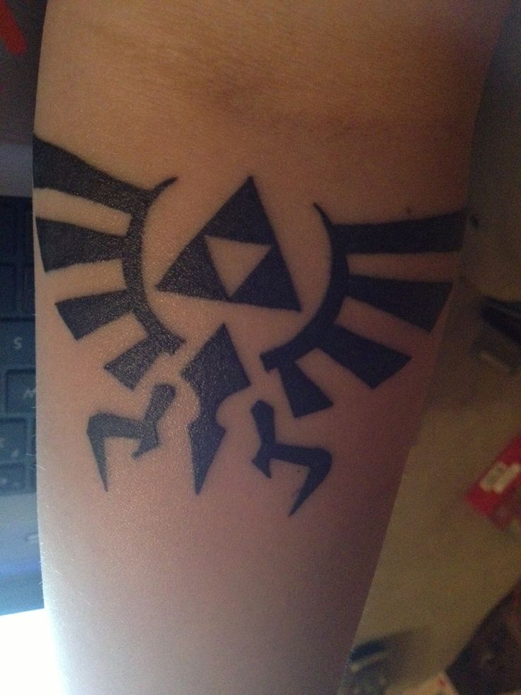 The Crest of Hyrule on my left forearm. I am absolutely in love. Done by Dan at Black Ink Tattoo in Crystal Lake, IL.