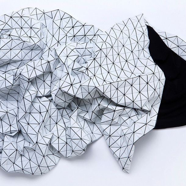 A super cool polygonal throw. Looks like a distorted game-landscape mesh when crumpled.
