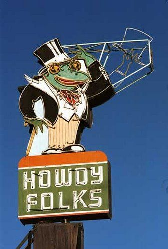 """""""Howdy Folks"""". The Green Frog sign. Our 'high tech' kind of sign when I was little. When it was dark, it looked like the frog was tipping his hat to you as you drove by!!!! Hahahaha"""