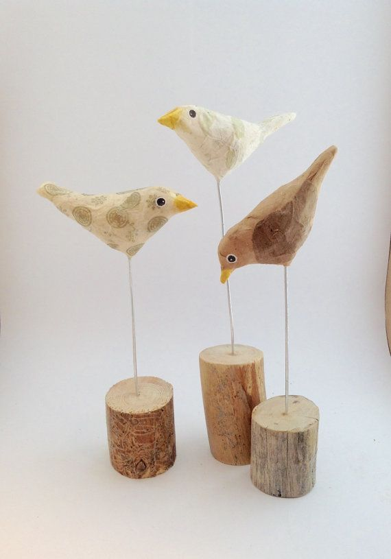 Bird of paperclay covered in old envelope. Bird on by maritmoss