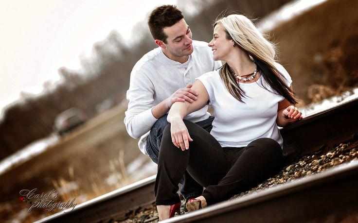 Regina-Wedding-Photography-Engagement photo on railway tracks - Regina